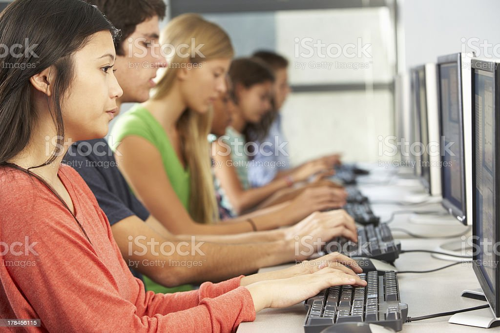 Group Of Students Working At Computers In Classroom stock photo