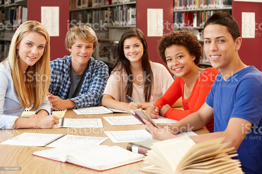 Group of students working together in library royalty-free stock photo