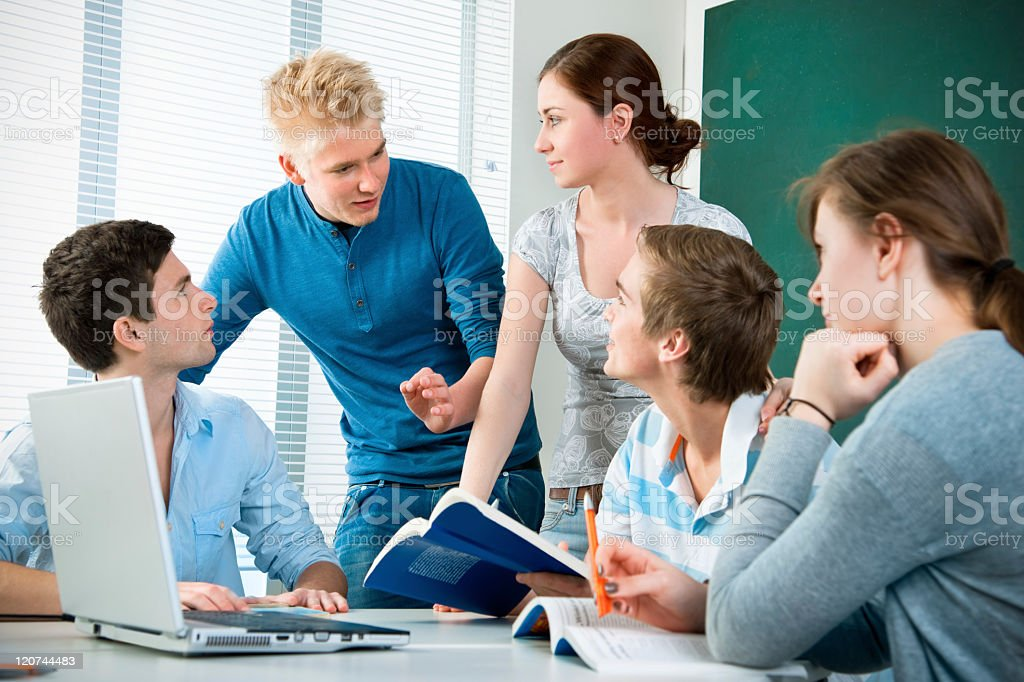 A group of students working together royalty-free stock photo