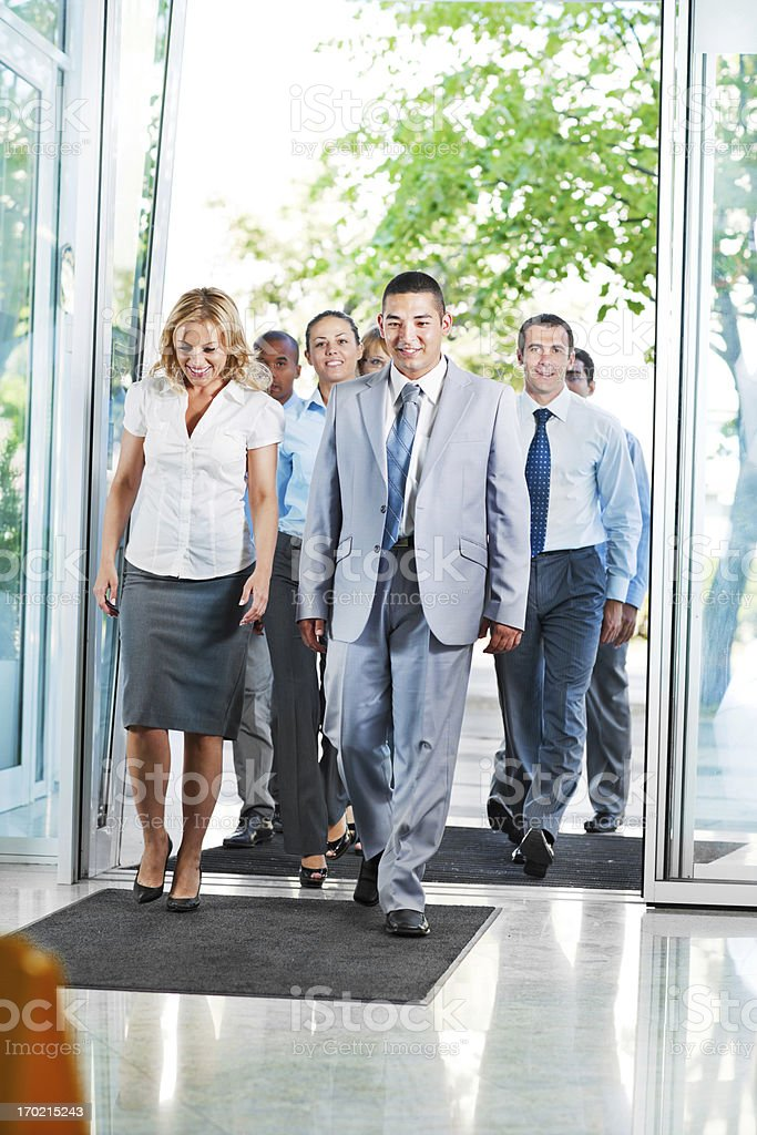Group of successful businesspeople entering the building. royalty-free stock photo