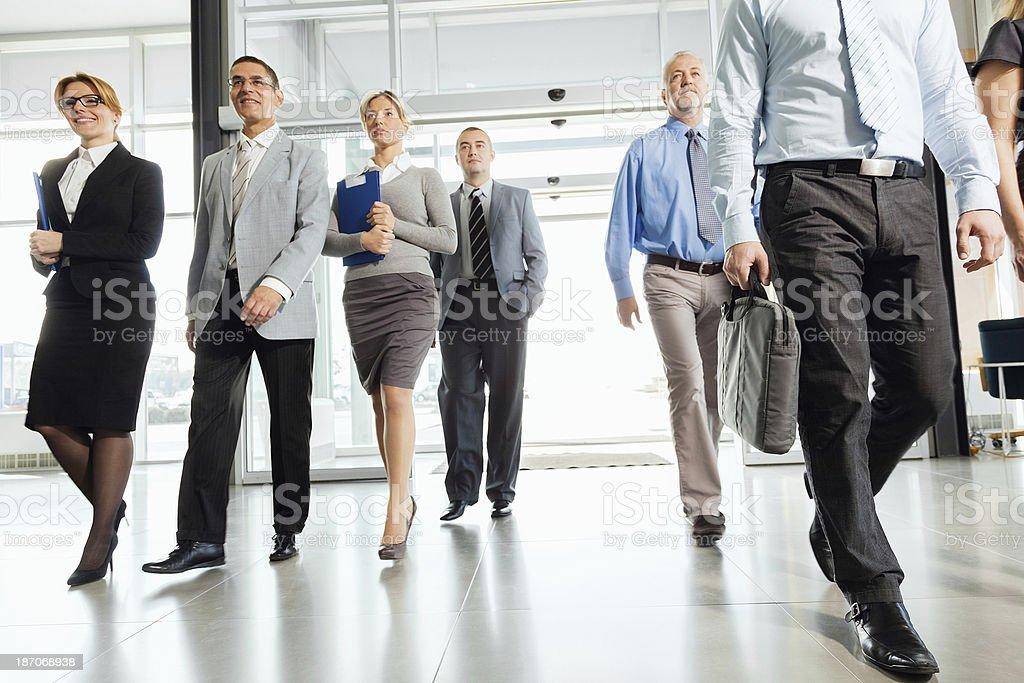 Group of successful businesspeople walking into the building. royalty-free stock photo