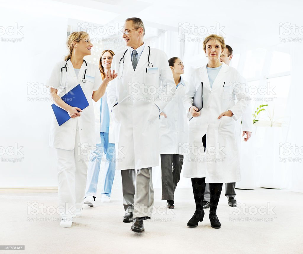 Group of successful doctors talking. royalty-free stock photo