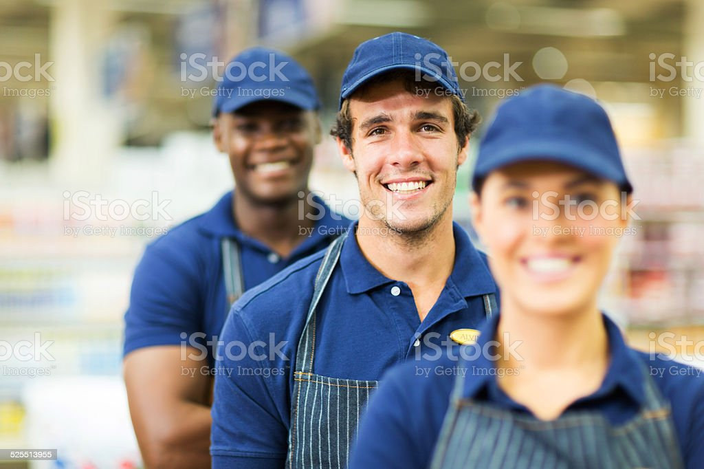 group of supermarket workers stock photo