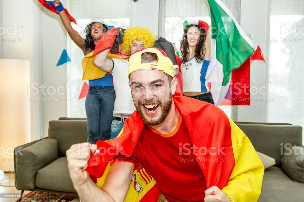 Group of supporters rejoicing stock photo