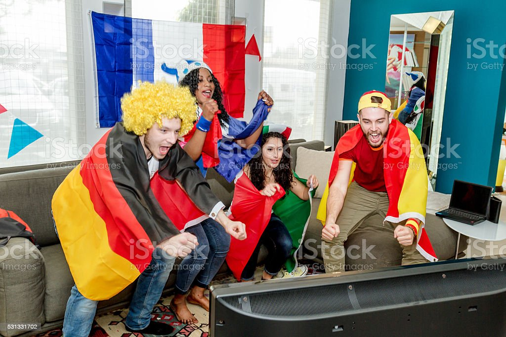 Group of supporters watching television stock photo