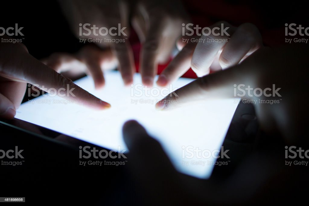 Group of tablet users stock photo