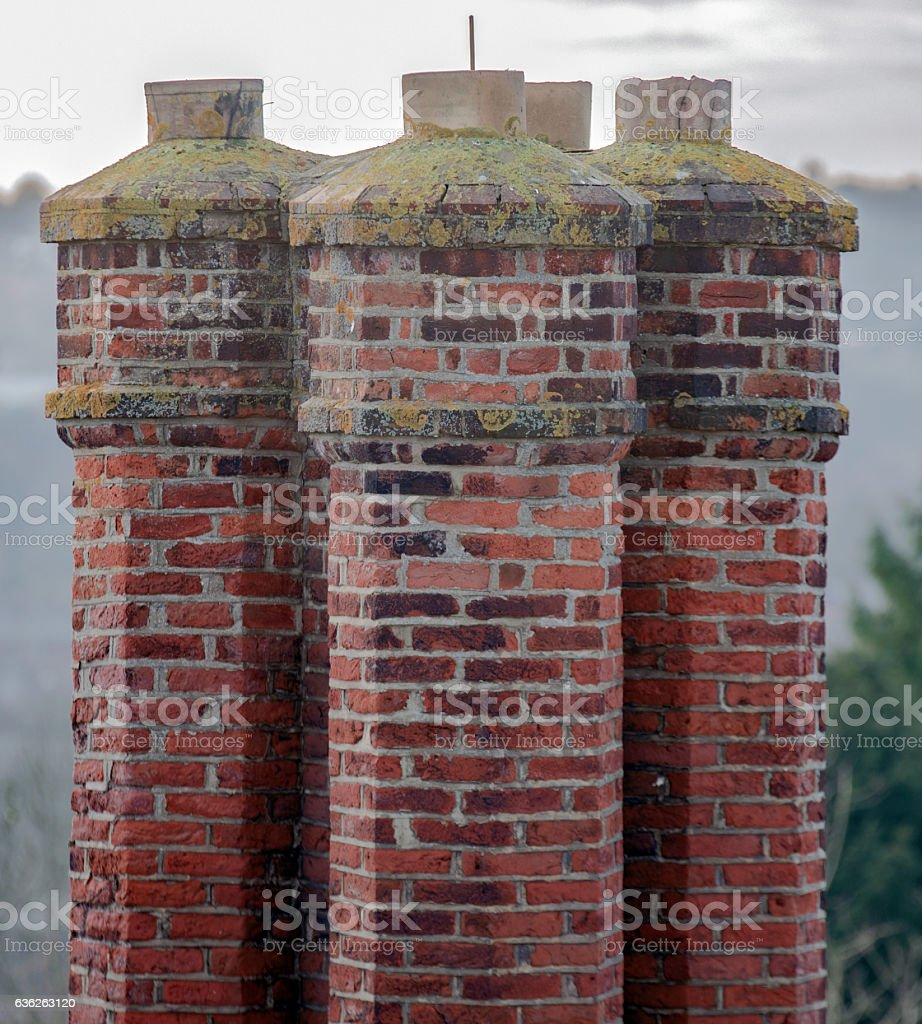 Group of tall chimneys on an old building stock photo
