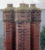Group of tall chimneys on an old building