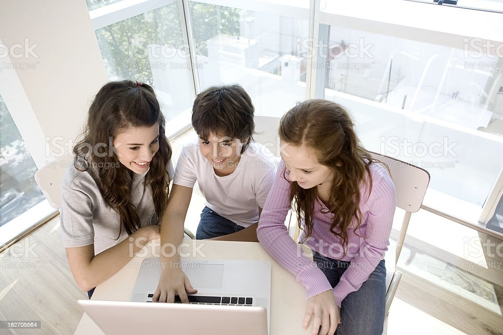 Group of teen friends with laptop royalty-free stock photo