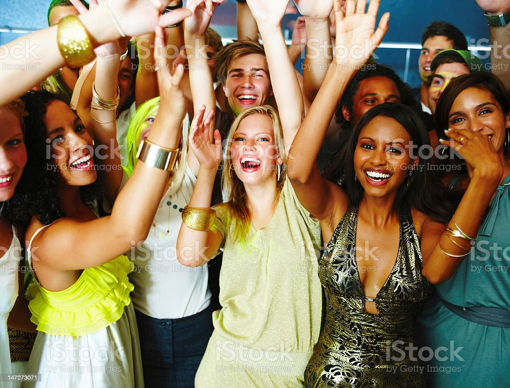 Group of teenage boys and girls dancing at nightclub royalty-free stock photo