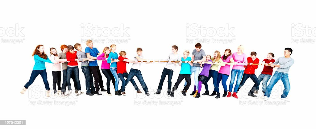 A group of teenage boys and girls playing tug of war royalty-free stock photo