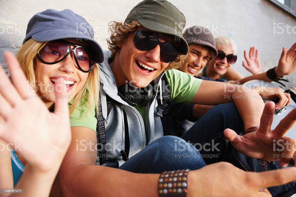 Group of teenage couples sitting together and smiling stock photo