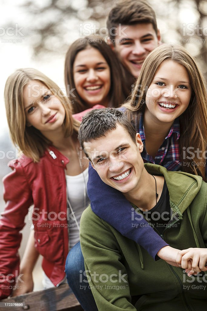 Group of teenage friends enjoying time outdoors royalty-free stock photo