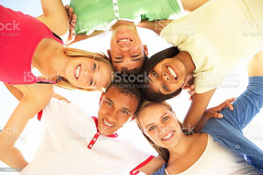 Group Of Teenage Friends Having Fun In Park stock photo