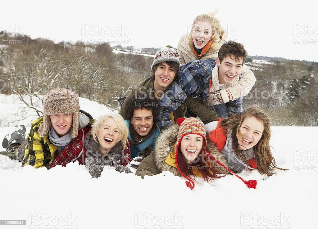Group Of Teenage Friends Having Fun In Snowy Landscape royalty-free stock photo