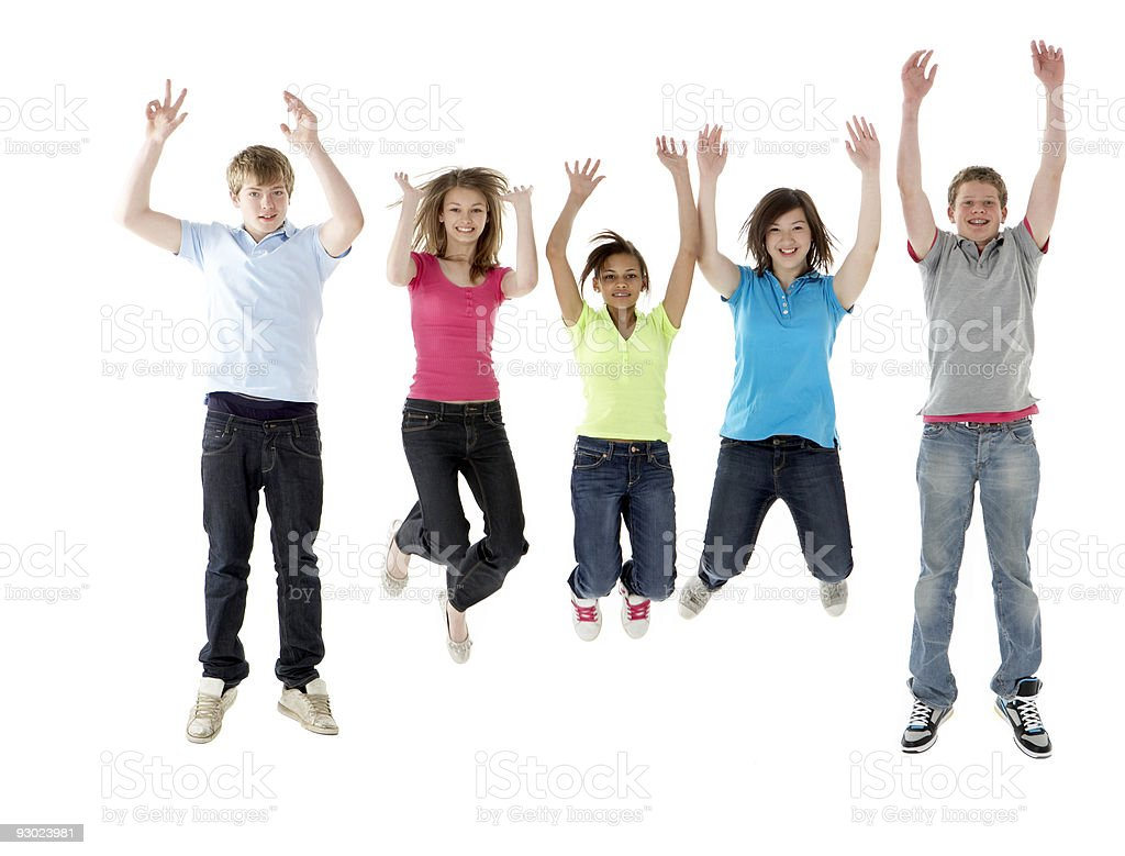 Group of Teenage Friends Jumping in Studio stock photo