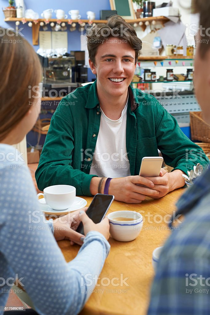 Group Of Teenage Friends Meeting In Cafe stock photo