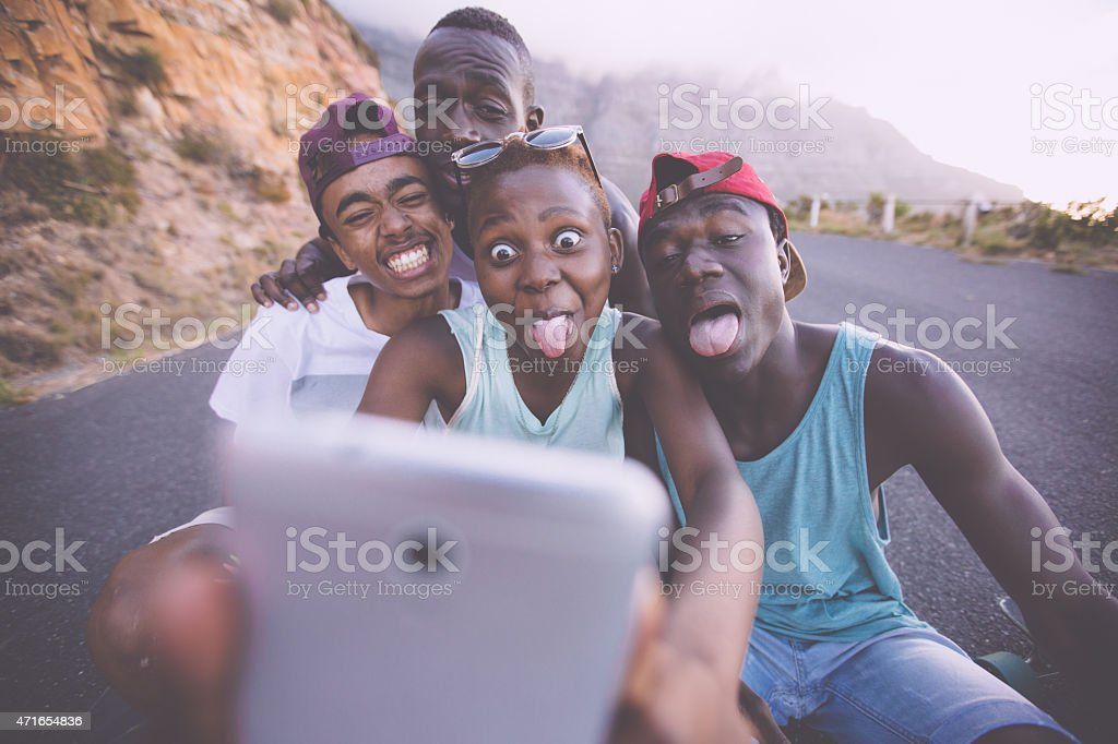 Group of teenage friends pulling faces for a selfie stock photo