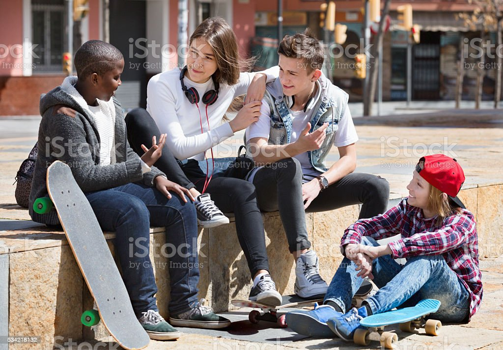 Group of teenage friends relaxing and chatting stock photo