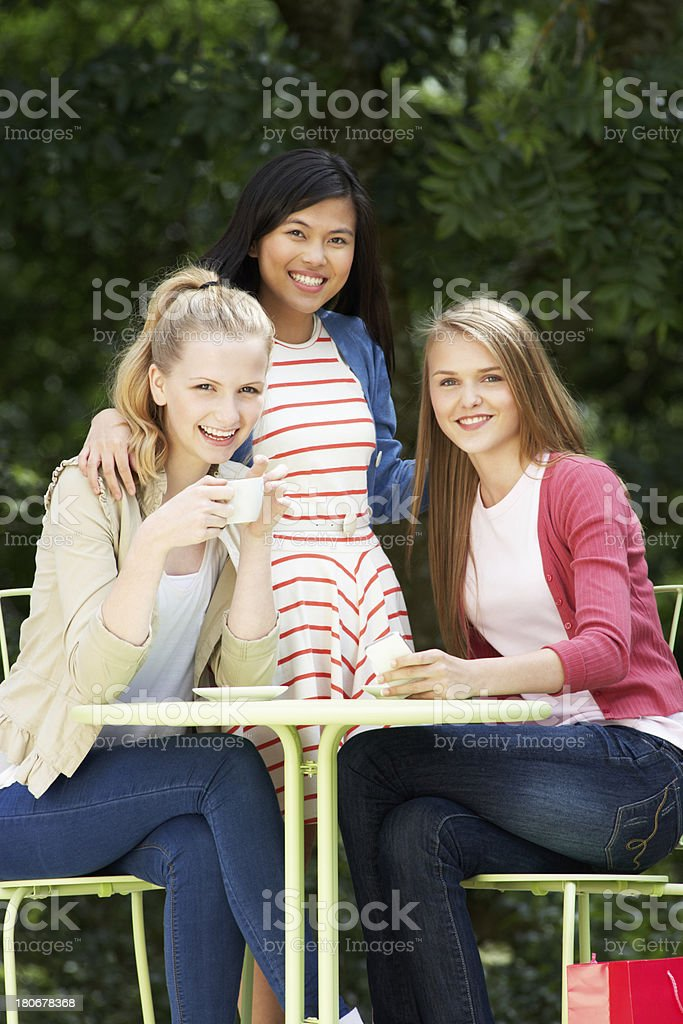 Group Of Teenage Girls Sitting At Outdoor cafe royalty-free stock photo