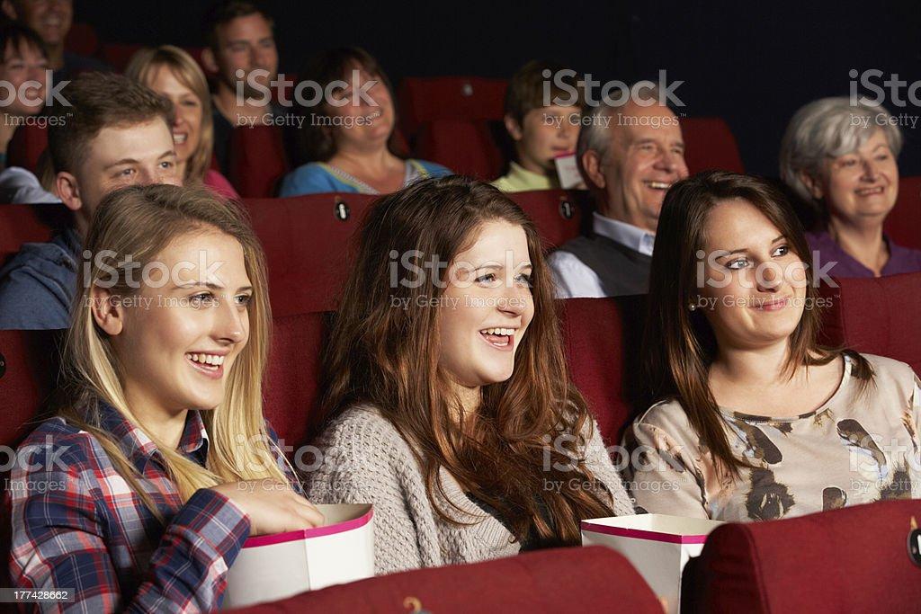 Group Of Teenage Girls Watching Film In Cinema royalty-free stock photo