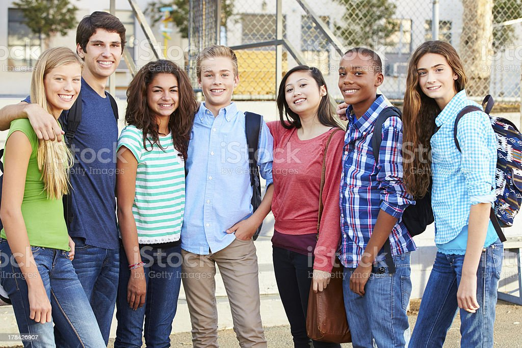 Group Of Teenage Pupils Outside Classroom stock photo