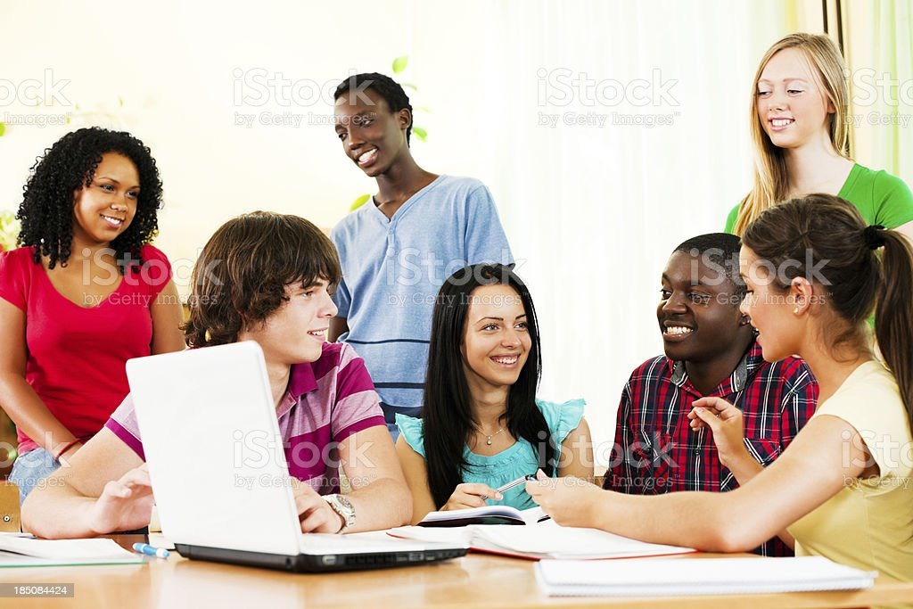 Group of teenage students using laptop. royalty-free stock photo