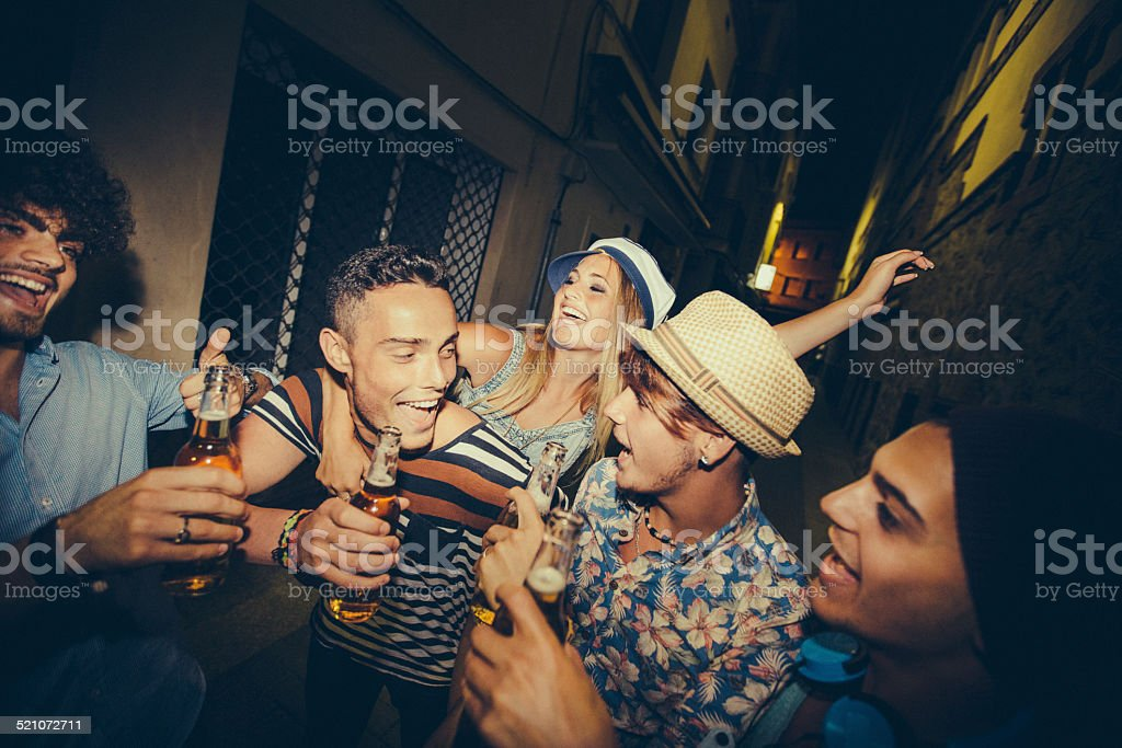 Group Of Teenager Friends Partying Together In Street stock photo