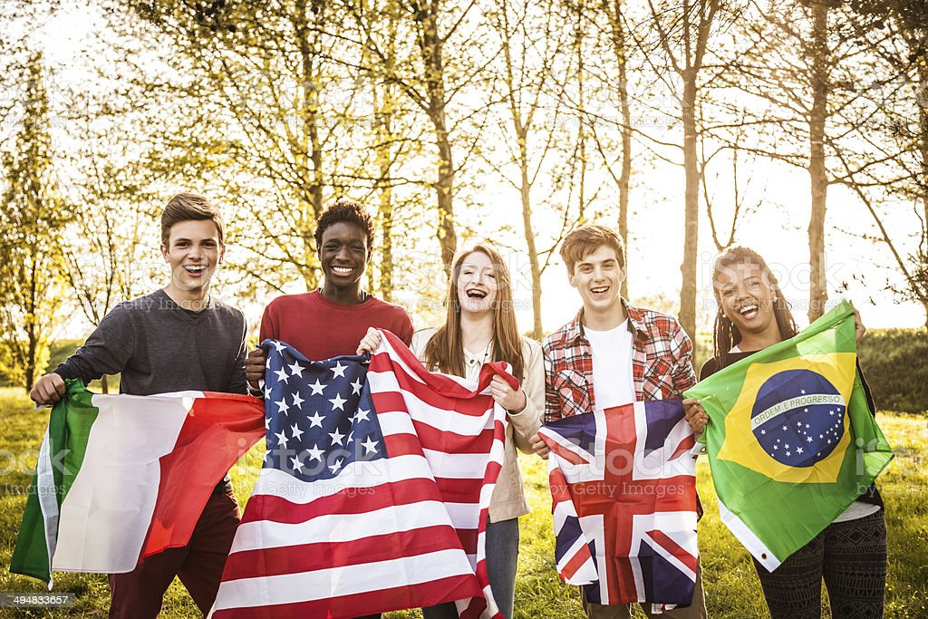 Group of teenager with national flags stock photo