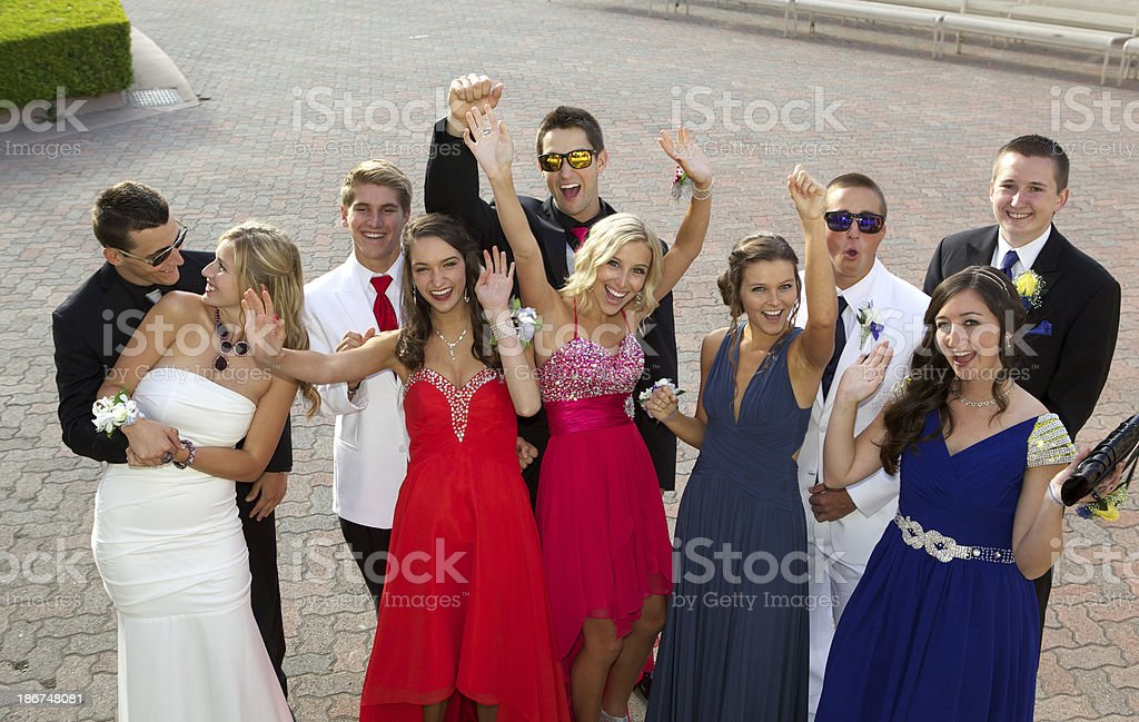 Group of Teenagers at the Prom  Having Fun Posing Outdoors stock photo