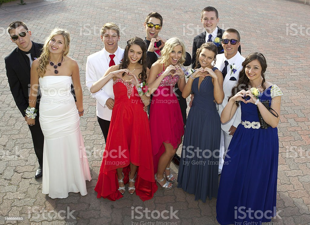 Group of Teenagers at the Prom Posing with Heart Hands royalty-free stock photo