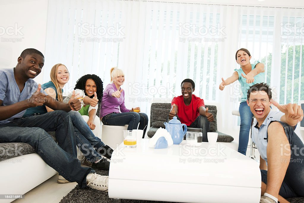 Group of teenagers enjoying in the living room. royalty-free stock photo