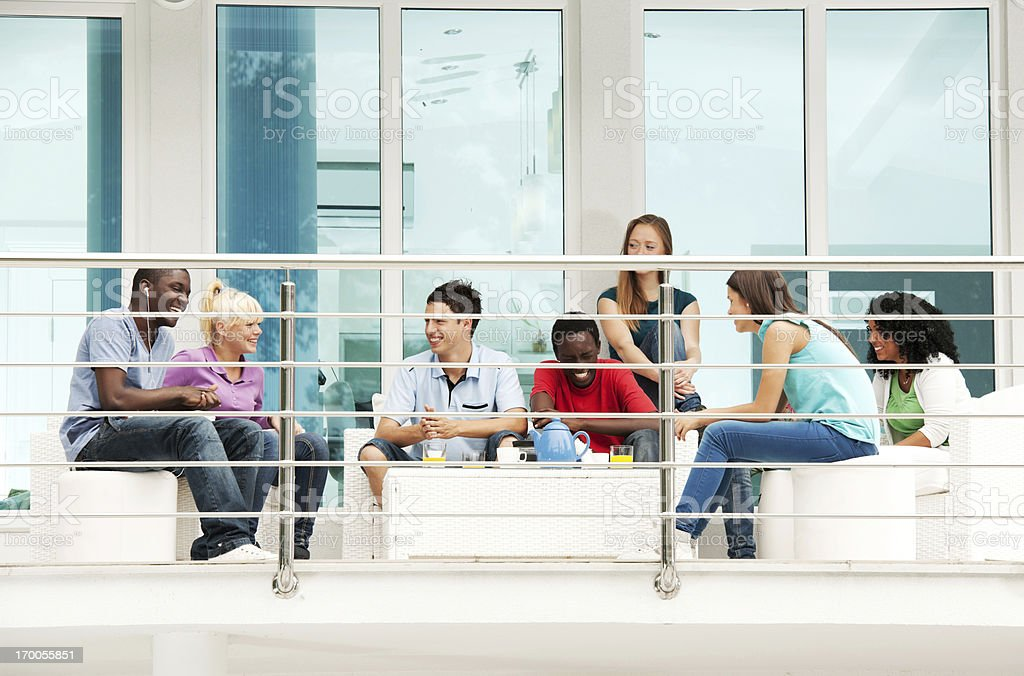 Group of teenagers enjoying on the terrace. royalty-free stock photo