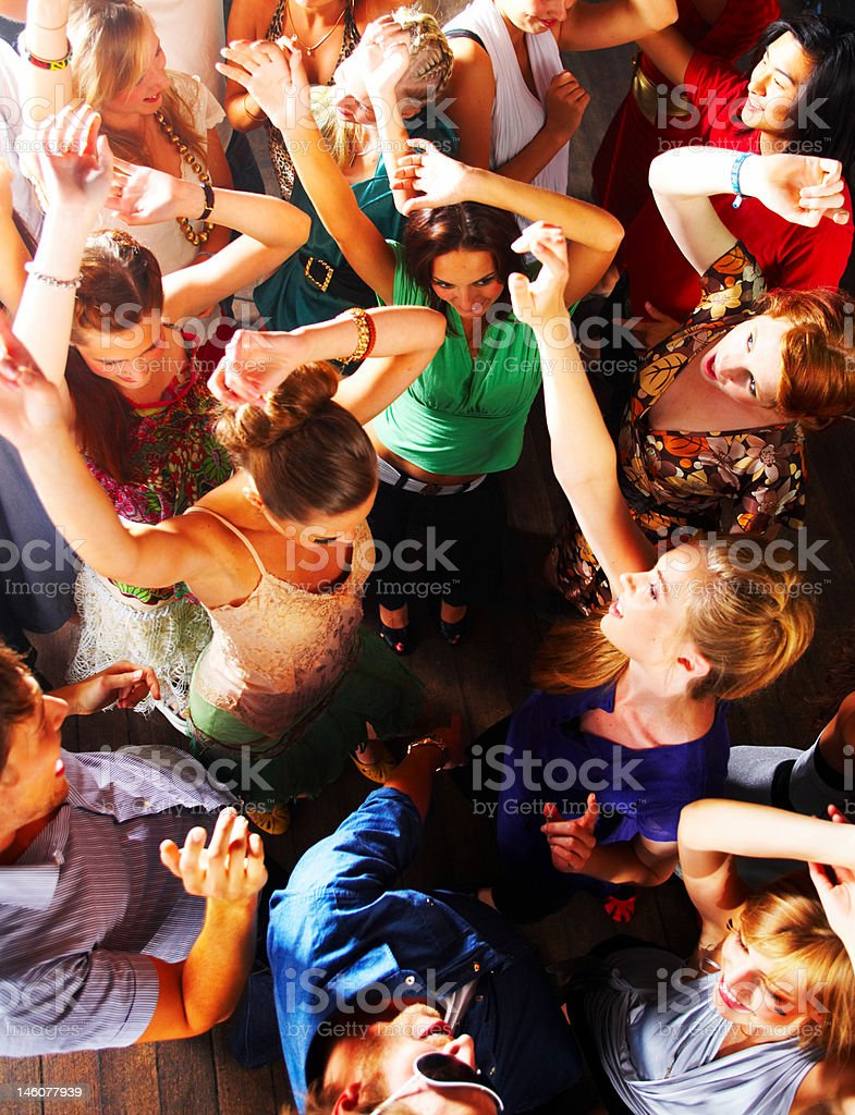 Group of teenagers enjoying party at disco stock photo