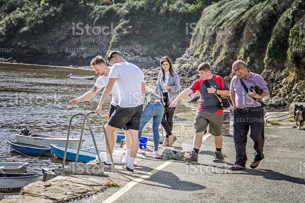Group of teenagers fishing for crabs stock photo