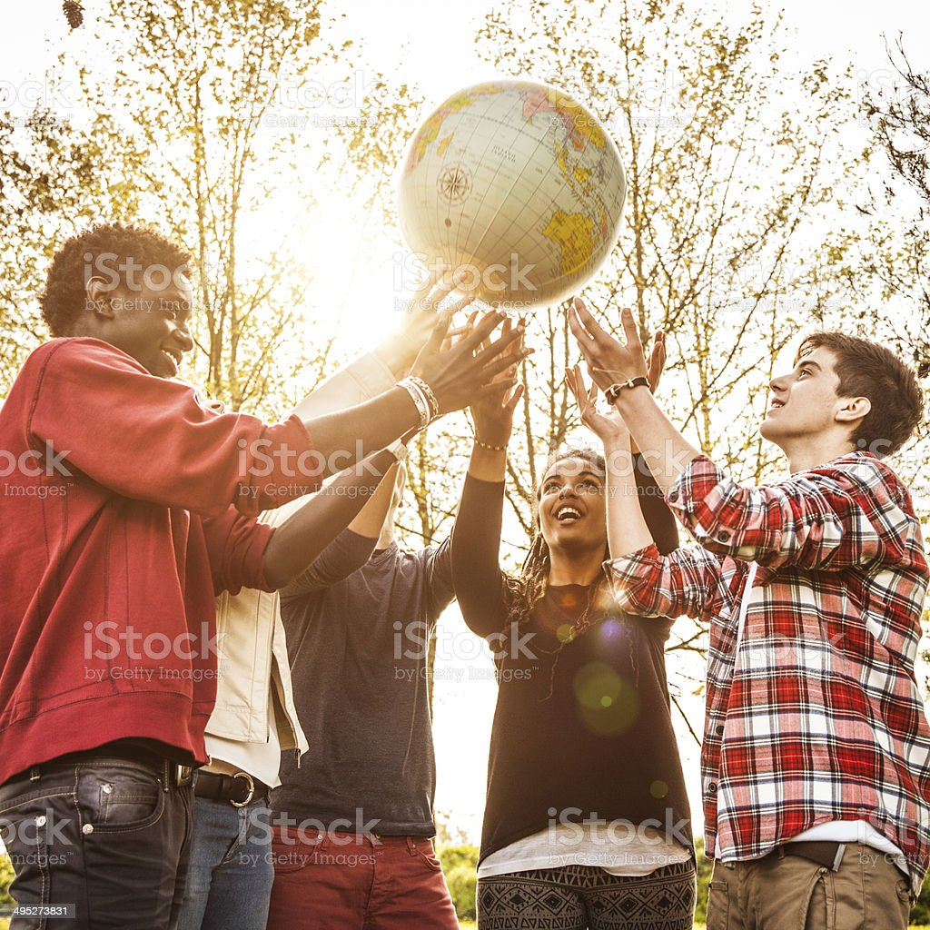 Group of teenagers holding an earth globe stock photo