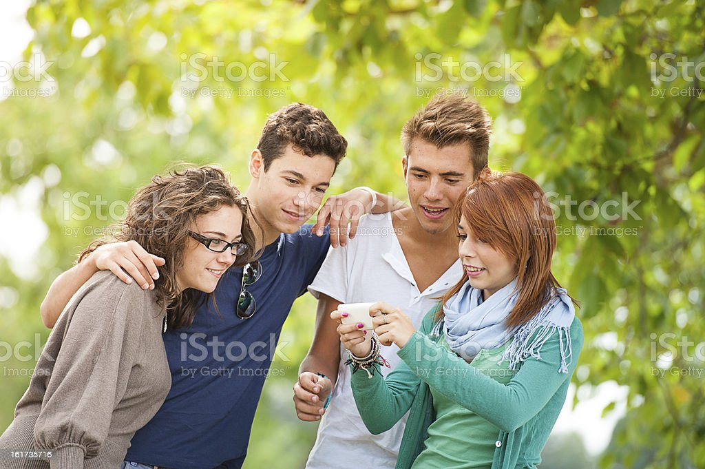 Group of teenagers posing for a photography royalty-free stock photo