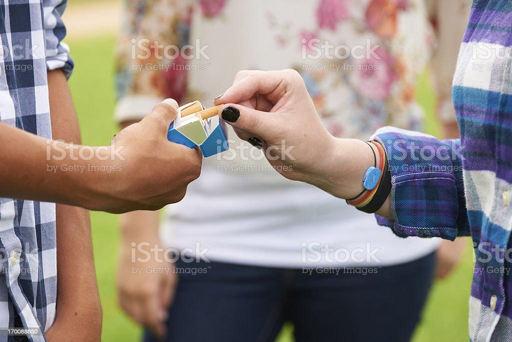 Group Of Teenagers Smoking stock photo