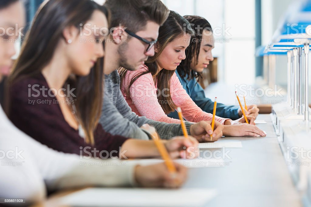 Group of teenagers taking a test stock photo