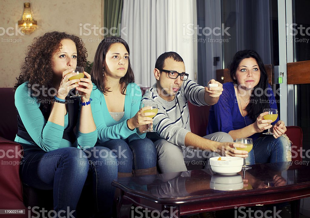 Group of teenagers watching television royalty-free stock photo