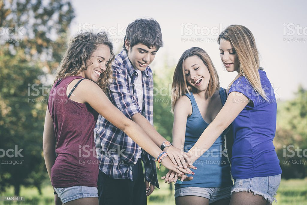 Group of Teenagers with Hands on Stack stock photo