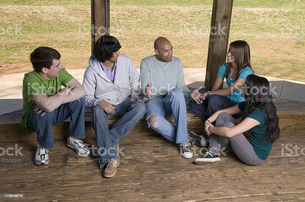 Group of Teens listening to Leader royalty-free stock photo