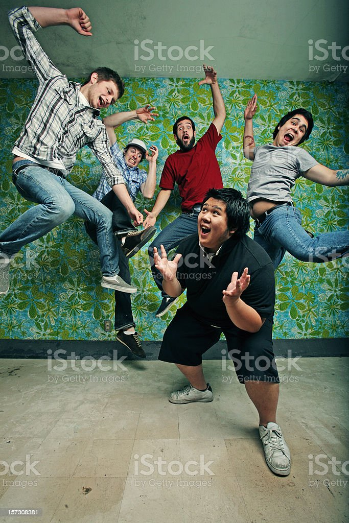 Group of Teens Scaring an Asian Guy royalty-free stock photo