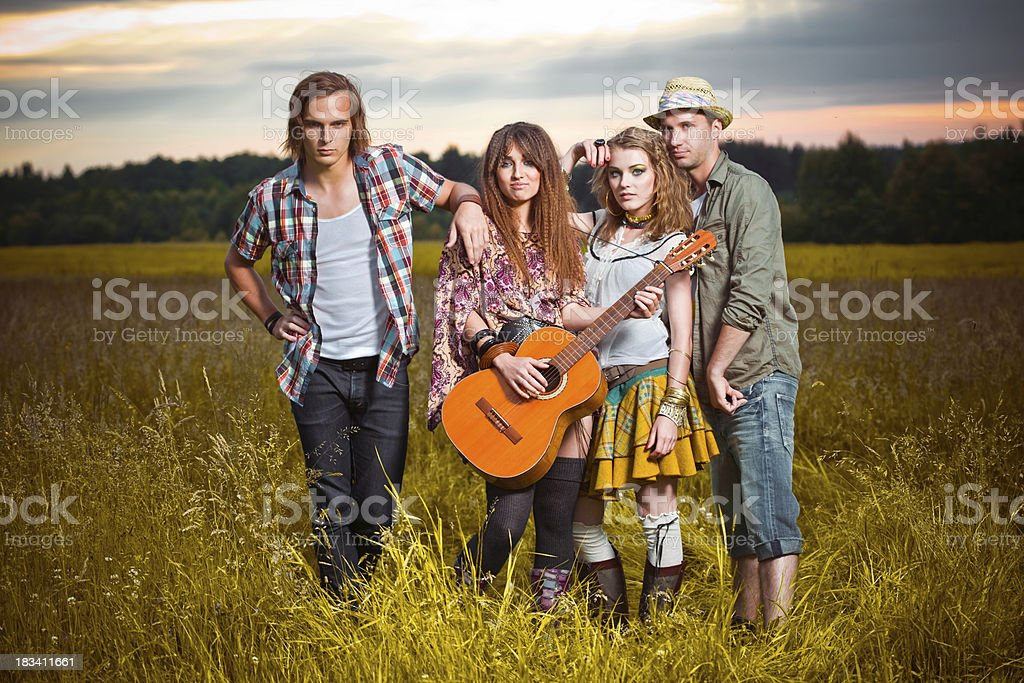 Group of teens standing in the field royalty-free stock photo