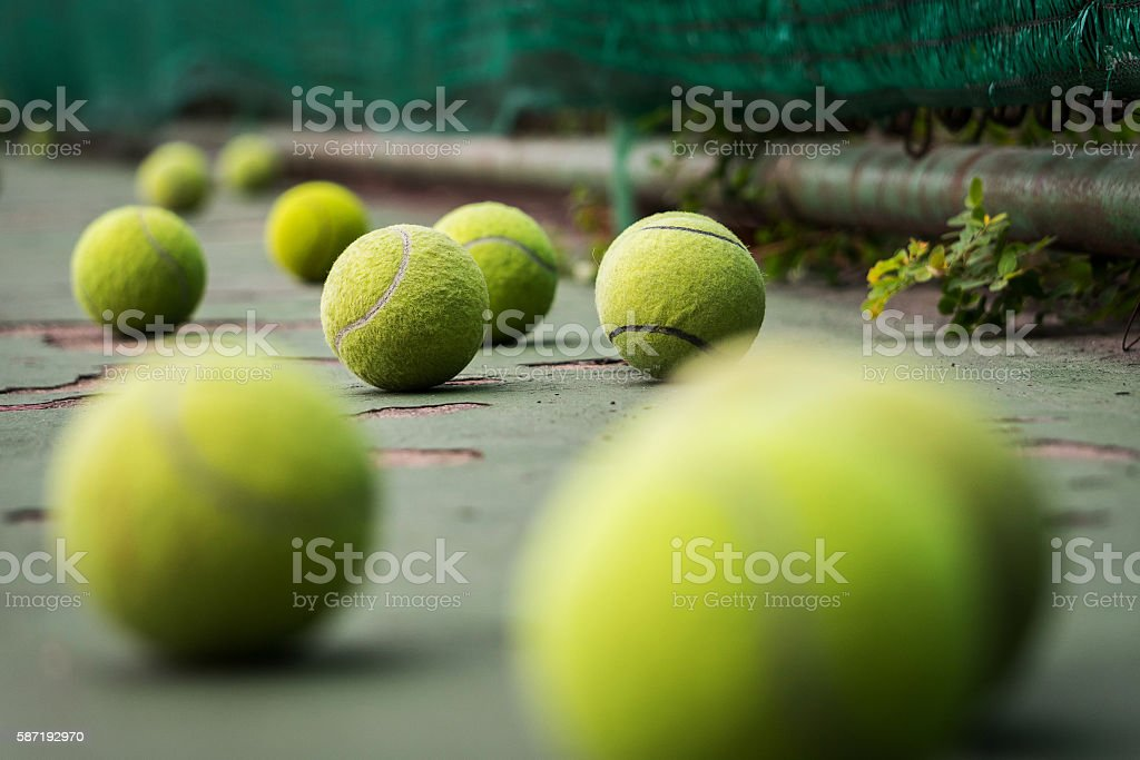 group of tennis balls on old tennis court stock photo
