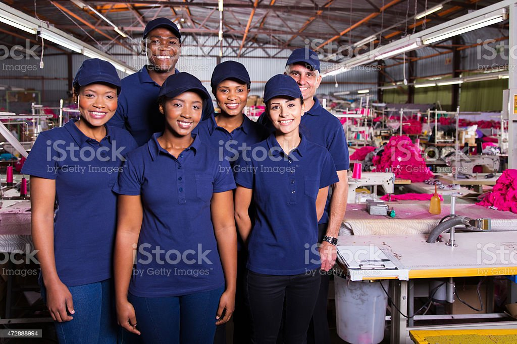 group of textile workers stock photo