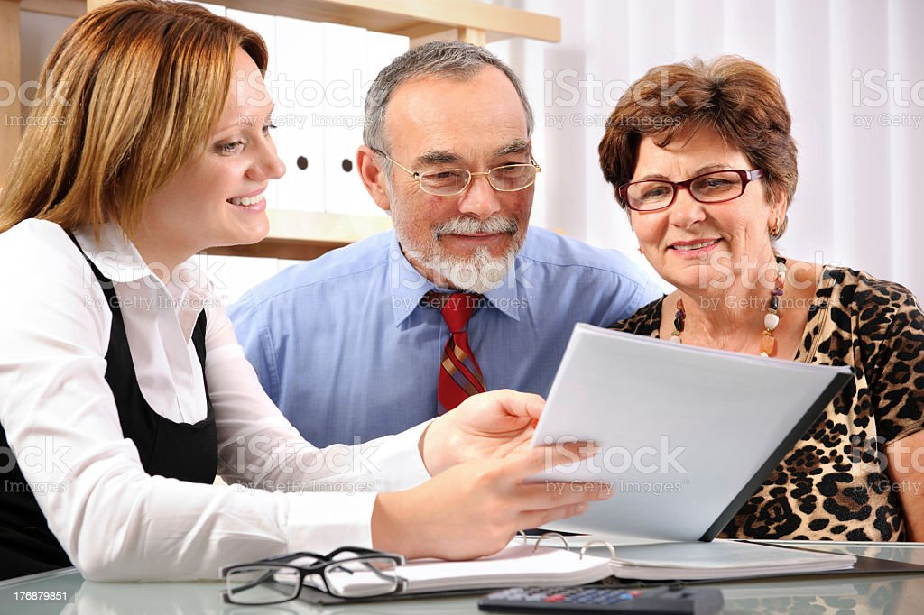 Group of three individuals having a business meeting stock photo