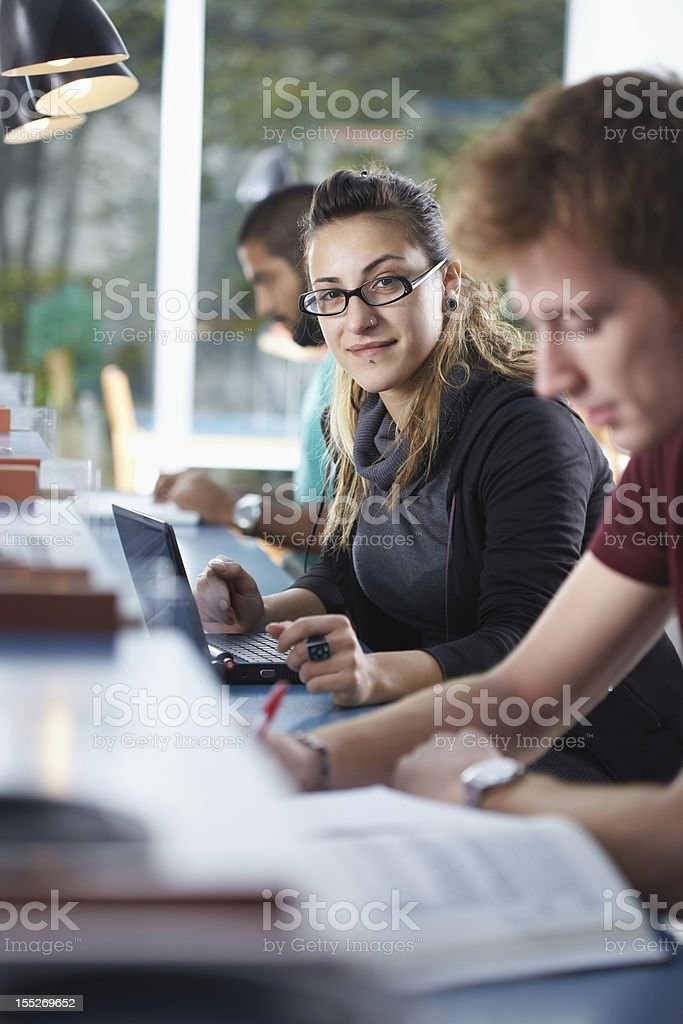 group of three people in library royalty-free stock photo