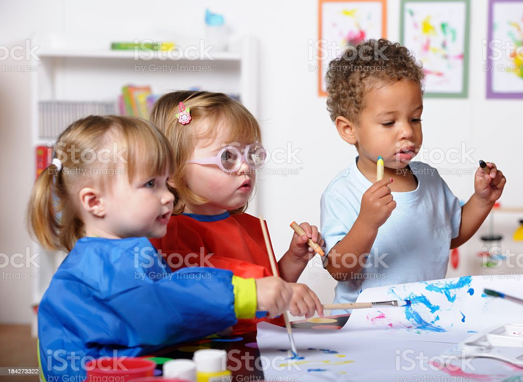 Group Of Toddlers Doing Art And Craft At Nursery stock photo