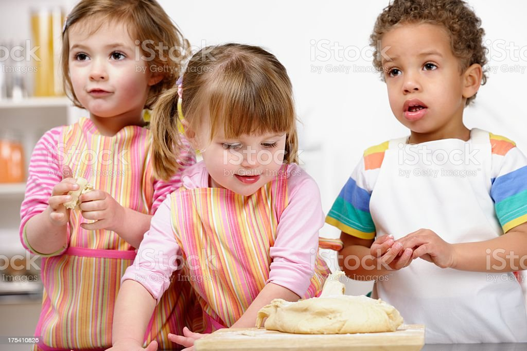 Group Of Toddlers/ Little Children Moulding Dough stock photo